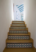 Detail of the bands of mosaic tiles that decorate a staircase in a narrow corridor in the Casita