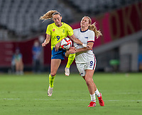 TOKYO, JAPAN - JULY 21: Kosovare Asllani #9 of Sweden collides with Lindsey Horan #9 of the USWNT during a game between Sweden and USWNT at Tokyo Stadium on July 21, 2021 in Tokyo, Japan.