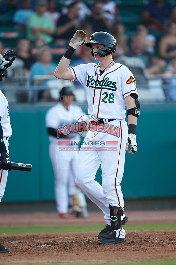 Sam Huff (28) of the Down East Wood Ducks high fives a teammate after hitting a home run against the Winston-Salem Dash at Grainger Stadium Field on May 17, 2019 in Kinston, North Carolina. The Dash defeated the Wood Ducks 8-2. (Brian Westerholt/Four Seam Images)