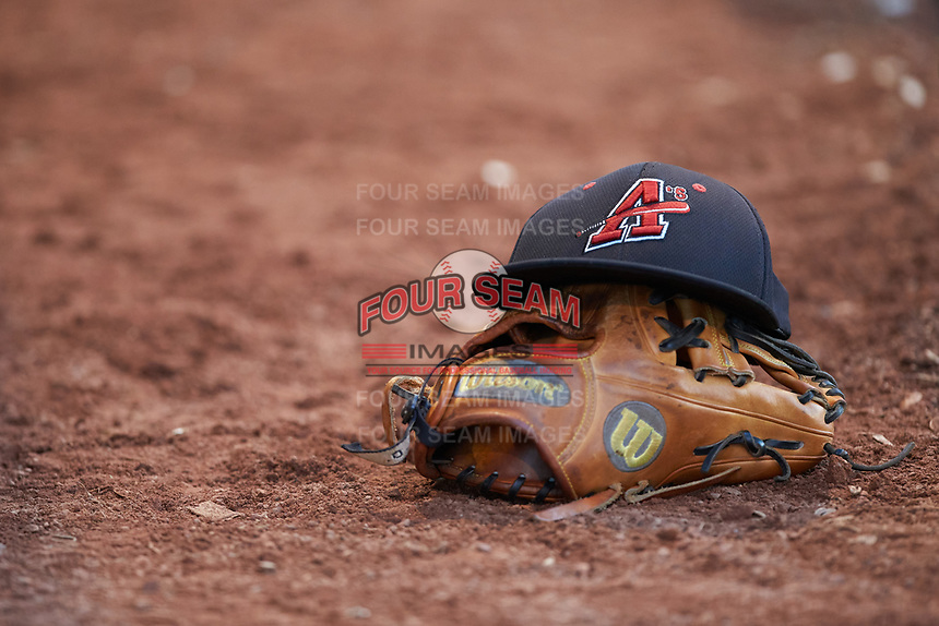 A Concord A's cap sits on top of a Wilson baseball glove during the Southern Collegiate Baseball League game against the Mooresville Spinners at Moor Park on July 31, 2020 in Mooresville, NC. The Spinners defeated the Athletics 6-3 in a game called after 6 innings due to rain. (Brian Westerholt/Four Seam Images)