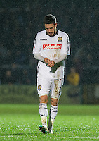 Liam Noble of Notts County walks to the dugout after being sent off during the Sky Bet League 2 match between Wycombe Wanderers and Notts County at Adams Park, High Wycombe, England on 15 December 2015. Photo by Andy Rowland.