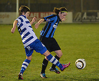 20140326 - AALTER , BELGIUM : Brugge's Lore Dezeure (r) pictured with Gent's Annelien Van Gansbeke (l) during the soccer match between the women teams of Club Brugge Vrouwen  and AA Gent  Ladies , on the 21th matchday of the BeNeleague competition Friday 14 March 2014 in Aalter. PHOTO DAVID CATRY