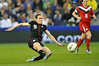USWNT midfielder Heather O'Reilly (9) shoots on goal.