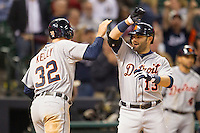 Detroit Tigers catcher Alex Avila (13) is greeted at the plate by teammate Don Kelly (32) after hitting a go-ahead two run home run in the ninth inning of the MLB baseball game against the Houston Astros on May 3, 2013 at Minute Maid Park in Houston, Texas. Detroit defeated Houston 4-3. (Andrew Woolley/Four Seam Images).