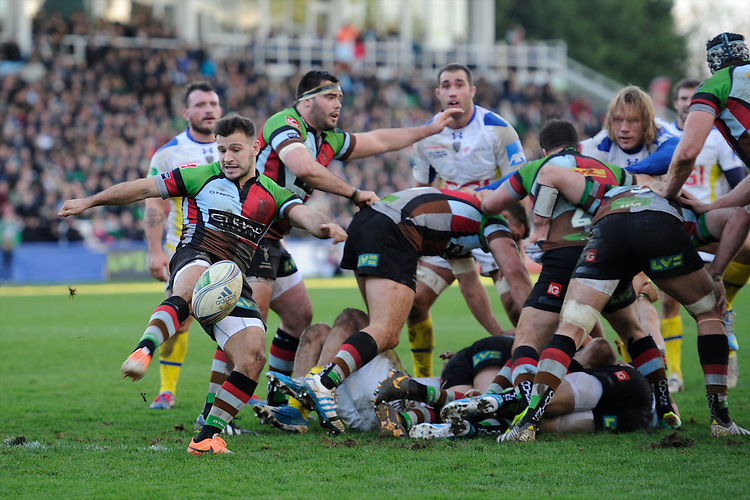 Danny Care of Harlequins sends up a box kick during the Heineken Cup Round 5 match between Harlequins and ASM Clermont Auvergne at the Twickenham Stoop on Saturday 11th January 2014 (Photo by Rob Munro)