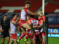 20th November 2020; Totally Wicked Stadium, Saint Helens, Merseyside, England; BetFred Super League Playoff Rugby, Saint Helens Saints v Catalan Dragons; Kevin Naiqama of St Helens celebrates with team mates  Kyle Amor and Tom Makinson of St Helens of St Helens after his 31st minute try