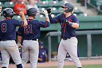 Jacson McGowan (34) of the Bowling Green Hot Rods celebrates his eighth-inning grand slam with Jonathan Aranda (8) and Erik Ostberg (21) in a game against the Greenville Drive on Sunday, May 9, 2021, at Fluor Field at the West End in Greenville, South Carolina. (Tom Priddy/Four Seam Images)