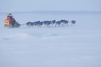 Mitch Seavey runs into the 35 mph wind on Norton Sound between Shaktoolik and Koyuk during Iditarod 2009