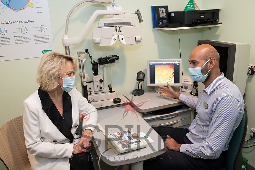 Sherrie Hewson discusses her analysis with Store Dorector Vineet Nehra