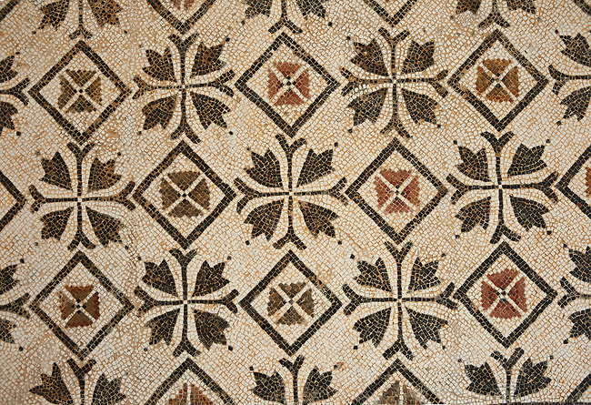 Pictures of a geometric crosses Roman mosaics design, from the ancient Roman city of Thysdrus. 3rd century AD. El Djem Archaeological Museum, El Djem, Tunisia.