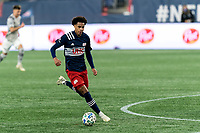 FOXBOROUGH, MA - NOVEMBER 20: DeJuan Jones #24 of New England Revolution on the attack during the Audi 2020 MLS Cup Playoffs, Eastern Conference Play-In Round game between Montreal Impact and New England Revolution at Gillette Stadium on November 20, 2020 in Foxborough, Massachusetts.
