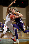 SIOUX FALLS, SD - MARCH 6: Colton Sandage #20 of the Western Illinois Leathernecks takes the ball to the basket against Stanley Umude #0 of the South Dakota Coyotes during the Summit League Basketball Tournament at the Sanford Pentagon in Sioux Falls, SD. (Photo by Dave Eggen/Inertia)