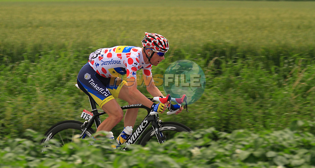 The breakaway group led by Polka Dot Jersey Michael Morkov (DEN) Saxo Bank-Tinkoff Bank pass through flat farmland near the village of Limont during Stage 2 of the 99th edition of the Tour de France 2012, running 207.5km from Vise to Tournai, Belgium. 2nd July 2012.<br /> (Photo by Eoin Clarke/NEWSFILE)