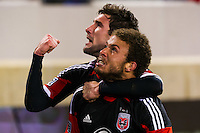 Nick DeLeon (18) of D. C. United celebrates scoring the game winning goal with Chris Pontius (13). D. C. United defeated the New York Red Bulls 1-0 (2-1 in aggregate) during the second leg of the MLS Eastern Conference Semifinals at Red Bull Arena in Harrison, NJ, on November 8, 2012.
