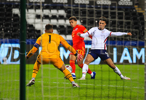 12th November 2020; Liberty Stadium, Swansea, Glamorgan, Wales; International Football Friendly; Wales versus United States of America; Brennan Johnson of Wales shoots at goal while under pressure from Antonee Robinson of USA