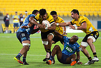 Ardie Savea is wrapped up during the Super Rugby Aotearoa match between the Hurricanes and Blues at Sky Stadium in Wellington, New Zealand on Saturday, 27 February 2021. Photo: Mike Moran / lintottphoto.co.nz