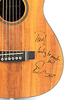 BNPS.co.uk (01202 558833)<br /> Pic: Bonhams/BNPS<br /> <br /> Pictured: The serviceman is selling his guitar, which is inscribed 'Tom! Lovely to meet you! Ed Sheeran'<br /> <br /> A guitar Ed Sheeran used for an impromptu performance to entertain the troops in Afghanistan has emerged for sale for £7,000.<br /> <br /> The superstar visited Camp Bastion in 2014 to boost morale and was handed the small acoustic Martin LXK2 by a serviceman.<br /> <br /> He had taken the instrument on tour of him to play to his comrades and chose this model as he was a fan of Sheeran's and had seen him use it.<br /> <br /> When Sheeran was handed the guitar, he noted it was a model he was familiar with and played his hit song 'A Team' for the small gathering.