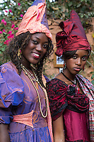 Goree Residents Dressed as Signares, Senegalese wives of 18th-19th-century French merchants.  Signare comes from the Portuguese senhora.  Though signares reached their apogee of social status in the late 18th century, the practice of taking local wives to facilitate trading relationships probably dates back to the arrival of the Portuguese on Goree in 1444.