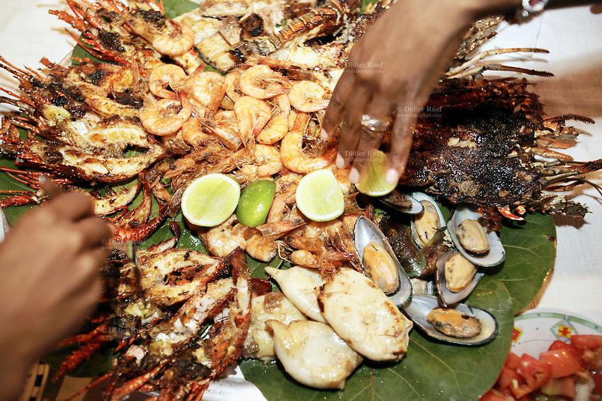 Dominican Republic. La Altagracia Province. Coastal resort of Punta Cana. Restaurant Captain Cook on the Playa Bavaro. El Cortecito. Parillada with fresh seafood, lobsters, shrimps, mussels and squids. © 2006 Didier Ruef