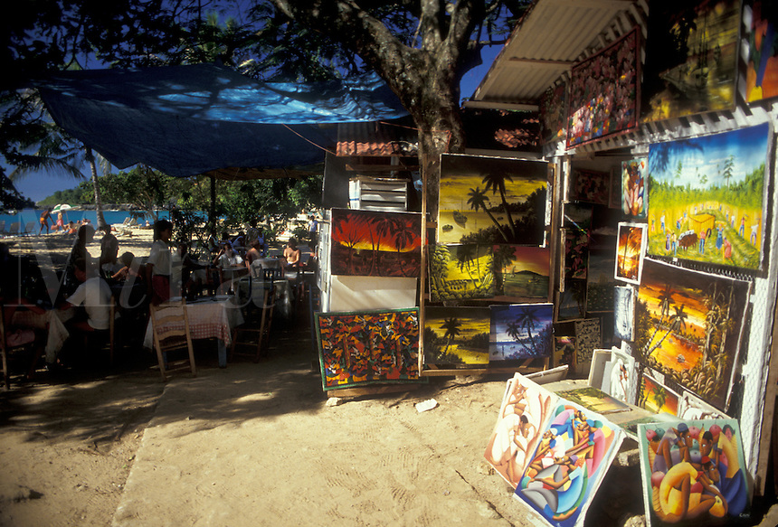 AJ2303, Dominican Republic, Caribbean, Caribbean Islands, Paintings for sale at outdoor market in Sosua in the Dominican Republic