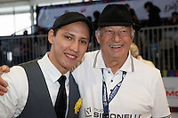 MELBOURNE, 26 MAY - William Hernandez from El Salvador pose for a photograph with Gianni Cassatini from Nuova Simonelli at the World Barista Championship 2013 in Melbourne, Australia. Photo Sydney Low / syd-low.com