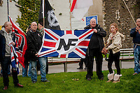 Saturday 05 April 2014<br /> Pictured: Men hold a national front flag <br /> Re: White Pride and Anti Fascist groups protest in Swansea City Cebtre
