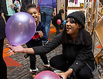 TORRINGTON, CT - 31 DECEMBER 2019 - 123119JW03.jpg -- Caliyah Hailey age 5 and Calanesha Hellandbrand play with their balloons  from the drop during the New Years Eve celebration at KidsPlay Children's Museum Tuesday morning. Jonathan Wilcox Republican-American