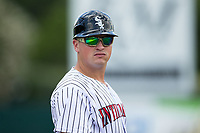 Kannapolis Intimidators manager Justin Jirschele (9) coaches third base during the game against the West Virginia Power at Kannapolis Intimidators Stadium on June 18, 2017 in Kannapolis, North Carolina.  The Intimidators defeated the Power 5-3 to win the South Atlantic League Northern Division first half title.  It is the first trip to the playoffs for the Intimidators since 2009.  (Brian Westerholt/Four Seam Images)