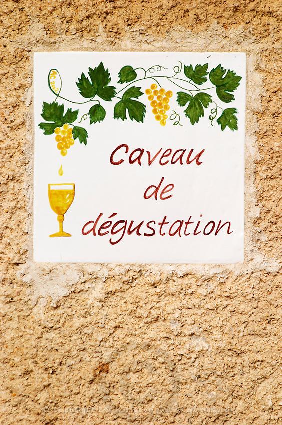 A sign showing the tasting room Caveau de degustation. Chateau Mourgues du Gres Grès, Costieres de Nimes, Bouches du Rhone, Provence, France, Europe