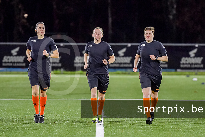 assistant referee Caroline Lanssens , referee Lois Otte , assistant referee Ella De Vries pictured before a female soccer game between  Racing Genk Ladies and Club Brugge YLA on the 10 th matchday of the 2020 - 2021 season of Belgian Scooore Womens Super League , friday 18 th of December 2020  in Genk , Belgium . PHOTO SPORTPIX.BE   SPP   STIJN AUDOOREN
