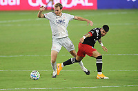WASHINGTON, DC - AUGUST 25: Henry Kessler #4 of New England Revolution battles for the ball with Junior Moreno #5 of D.C. United during a game between New England Revolution and D.C. United at Audi Field on August 25, 2020 in Washington, DC.