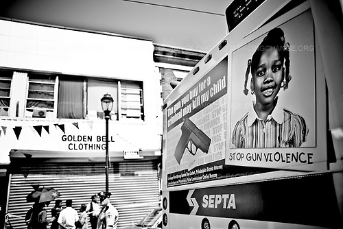 "Philadelphia Pennsylvania USA<br /> 2008<br /> <br /> A SEPTA bus passing by the crime scene were Fakhur Uddin, a 20 year-old immigrant from Bangladesh was killed. The sign reads ""The gun you buy from a criminal may kill my child. "" Stop Gun Violence."""