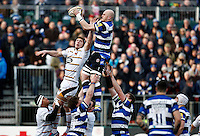 Photo: Richard Lane/Richard Lane Photography. Bath Rugby v Wasps. Aviva Premiership. 10/01/2015. Bath's Matt Garvey is challenged by Wasps' Kearnan Myall at a lineout.