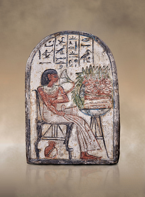 """Ancient Egyptian Ra stele , limestone, New Kingdom, 19th Dynasty, (1279-1190 BC), Deir el-Medina,  Egyptian Museum, Turin. <br /> <br /> On this round-topped stele, the deceased Pashed, <br /> """"excellent spirit of Ra"""", akh-ikr, is pictured left, <br /> seated on a chair with lion's paws, smelling the lotus <br /> flower. The offering table holds a basket containing <br /> various offerings. A large open pomegranate, containing <br /> a great quantity of seeds, appears under the chair. The <br /> colours on this stele are well preserved.<br /> <br /> Akh iqer en Ra """" the excellent spirit of Ra' stele. The individual is smelling a lotus flower. One of three stele forund in different rooms of houses in Deir el-Medina where they stood in niches."""