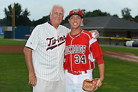 Former Minnesota Twins pitcher Jim Perry poses for a photo with Batavia Muckdogs pitcher Robert Ravago (34) after throwing out the ceremonial first pitch before a game against the Jamestown Jammers on July 23, 2013 at Dwyer Stadium in Batavia, New York.  Jamestown defeated Batavia 7-0.  (Mike Janes/Four Seam Images)