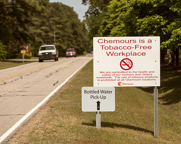 May 4, 2018. Fayetteville, North Carolina.<br /> <br /> Signs on the access road that leads to the Chemours plant.<br /> <br /> The Chemours Company, a spin off from DuPont, manufactures many chemicals at its plant in Fayetteville, NC. One of these, commonly referred to as GenX, is part of the process of teflon manufacturing. Chemours has been accused of dumping large quantities of GenX into the Cape Fear River and polluting the water supply of city's down river and allowing GenX to leak into local aquifers.