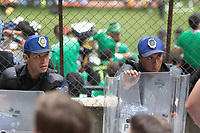 MEXICO CITY, MEXICO - June 11, 2017: Mexico police officers cordon off USA fans attend the World Cup Qualifier match against Mexico at Azteca Stadium.