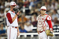 North Carolina State pitcher Brad Stone (26) talks with catcher Brett Austin (11) during Game 10 of the 2013 Men's College World Series against the North Carolina Tar Heels on June 20, 2013 at TD Ameritrade Park in Omaha, Nebraska. The Tar Heels defeated the Wolfpack 7-0, eliminating North Carolina State from the tournament. (Andrew Woolley/Four Seam Images)