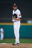 Rochester Red Wings pitcher Cole Johnson (19) looks in for the sign during a game against the Pawtucket Red Sox on July 1, 2015 at Frontier Field in Rochester, New York.  Rochester defeated Pawtucket 8-4.  (Mike Janes/Four Seam Images)