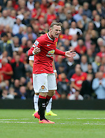 Pictured: Wayne Rooney of Manchester United celebrating his equaliser making the score 1-1. Saturday 16 August 2014<br />