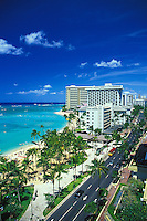 View of Waikiki Beach and Kalakaua ave.on a sunny hawaiian day.Hotels seen are Sheraton Moana Surfrider,Ourigger Waikiki and Sheraton Waikiki.
