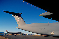 """US Air Force Military Aircraft on Static Display - at Abbotsford International Airshow, BC, British Columbia, Canada - Lockheed C-5 Galaxy Cargo Transporter in foreground, and Rockwell (Boeing) B-1B Lancer Bomber (aka the """"Bone"""") in background"""