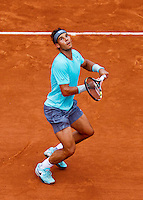 France, Paris, 26.05.2014. Tennis, Roland Garros, Rafael Nadal (ESP) is anticipating a smash in his match against Robby Ginepri (USA)<br /> Photo:Tennisimages/Henk Koster