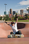 Skateboarder at the Denver Skatepark, near downtown Denver, Colorado,