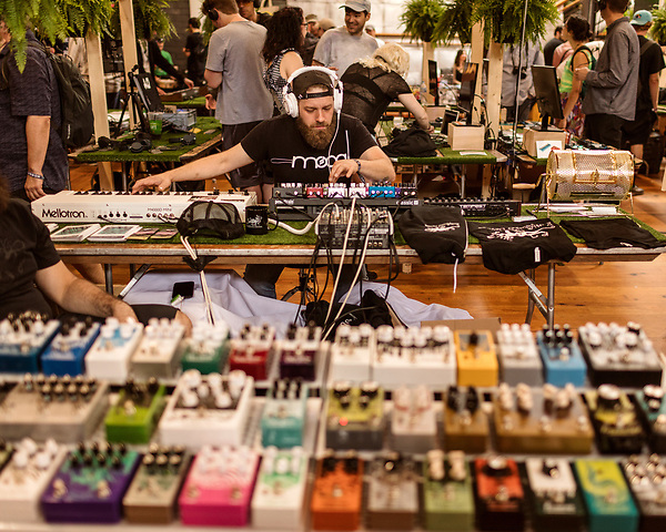 May 18, 2018. Durham, North Carolina.<br /> <br /> TJ Mills, of Asheville, NC, plays with various effects pedals.<br /> <br /> A Modular Marketplace for all things Moog-related was held at Bay 7 of the American Tobacco Campus. <br /> <br /> Moogfest 2018 showcases 4 days of music, art and technology spread out amongst venues in and around downtown Durham.