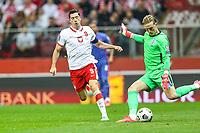 8th September 2021; PGE National Stadium, Warsaw, Poland: FIFA World Cup 2022 Football qualification, Poland versus England;  ROBERT LEWANDOWSKI tries to block the clearance of  JORDAN PICKFORD