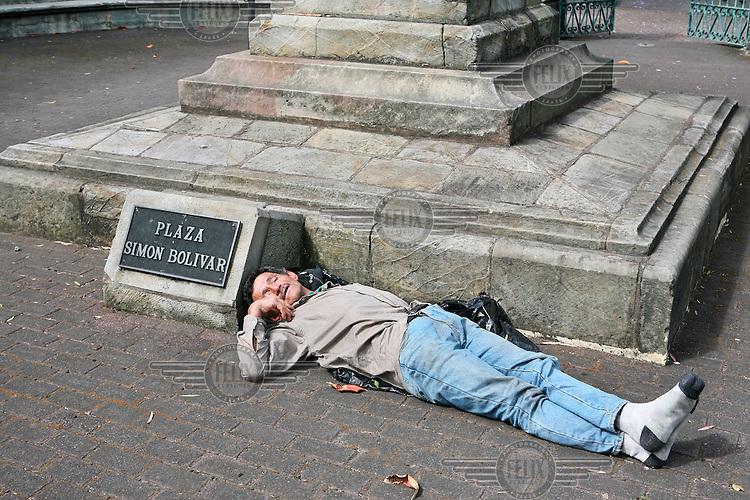 Homeless man sleeping on the Plaza Simon Bolivar in the capital San Jose.