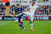 SWANSEA, WALES - MAY 17: Frank Lampard of Manchester City  and Gylfi Sigurosson of Swansea City in action during the Premier League match between Swansea City and Manchester City at The Liberty Stadium on May 17, 2015 in Swansea, Wales.  (Photo by Athena Pictures/Getty Images)