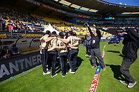 The Black Caps huddle before the 5th international men's T20 cricket match between the New Zealand Black Caps and Australia at Sky Stadium in Wellington, New Zealand on Sunday, 7 March 2021. Photo: Dave Lintott / lintottphoto.co.nz