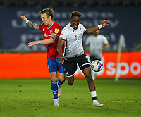 20th April 2021; Liberty Stadium, Swansea, Glamorgan, Wales; English Football League Championship Football, Swansea City versus Queens Park Rangers; Stefan Johansen of Queens Park Rangers and Jamal Lowe of Swansea City  jostle for possession